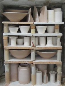nice full kiln load packed ...will fire thursday. running a bit behind  schedule but sometimes thats how it goes....am experimenting in a small test kiln painting on small commercially glazed tiles with oxides and underglaze colour for a commercial application.